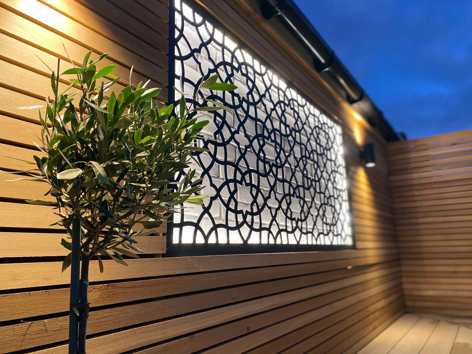 Back garden in Radlett - backlit metal trellis
